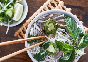 overhead photo of eating vietnamese beef pho